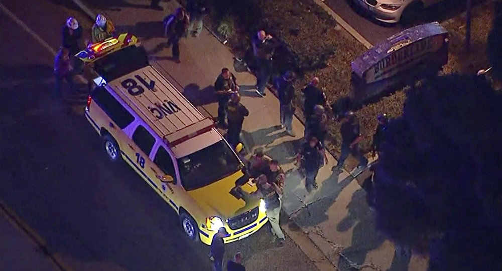 This image made from aerial video show officers around a Police SUV in the vicinity of a shooting in Thousand Oaks, California, early Thursday, Nov. 8, 2018