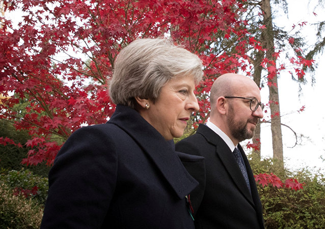 British Prime Minister Theresa May and Belgian counterpart Charles Michel attend a ceremony at the Saint Symphorien Military Cemetery marking the 100th anniversary of the end of the First World War, in Mons, Belgium November 9, 2018