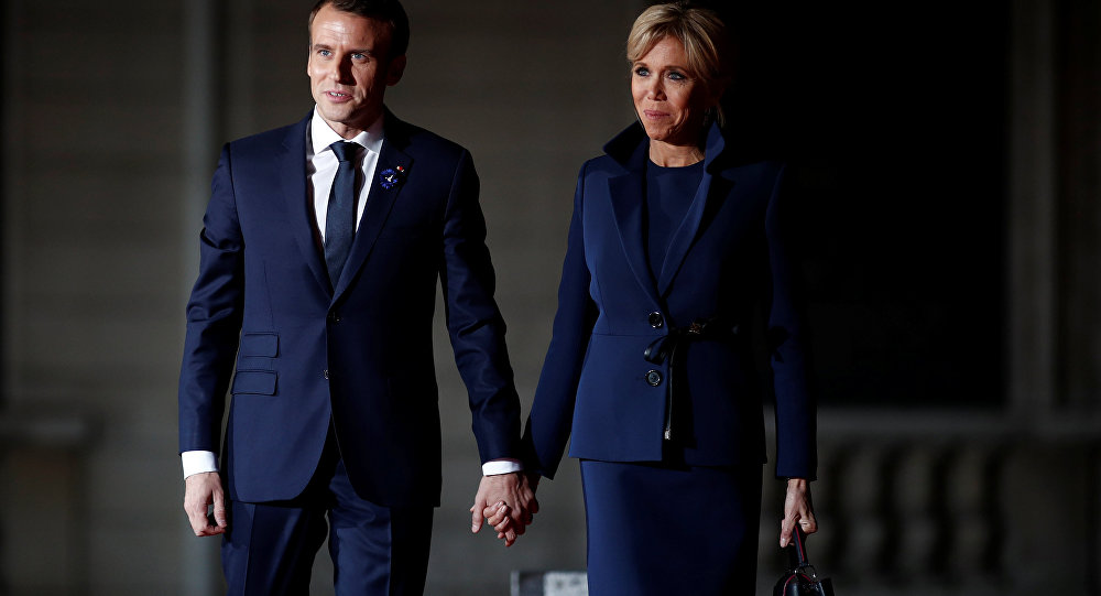 French President Emmanuel Macron and his wife Brigitte Macron arrive to attend a dinner at the Orsay Museum as part of the commemoration ceremony for Armistice Day, 100 years after the end of the First World War, in Paris