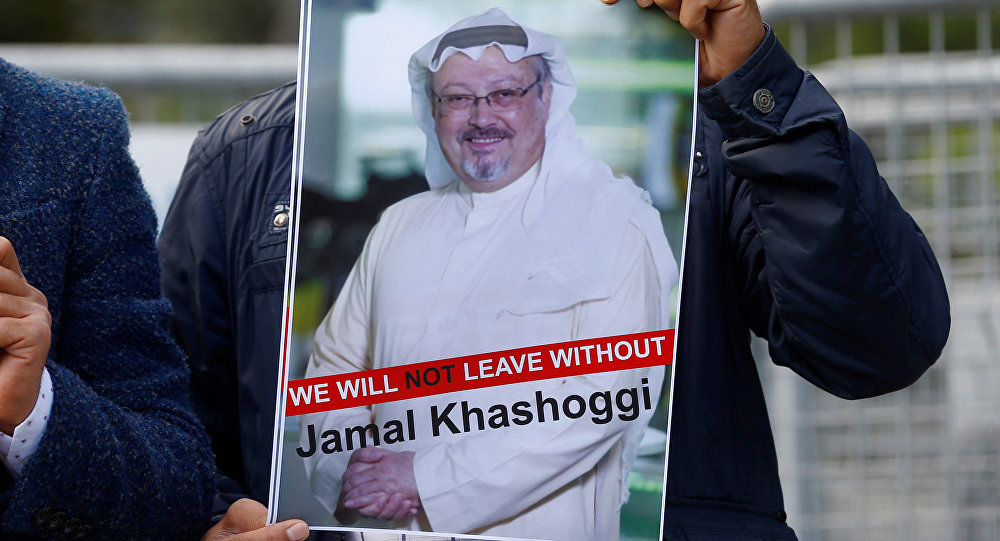 A demonstrator holds picture of Saudi journalist Jamal Khashoggi