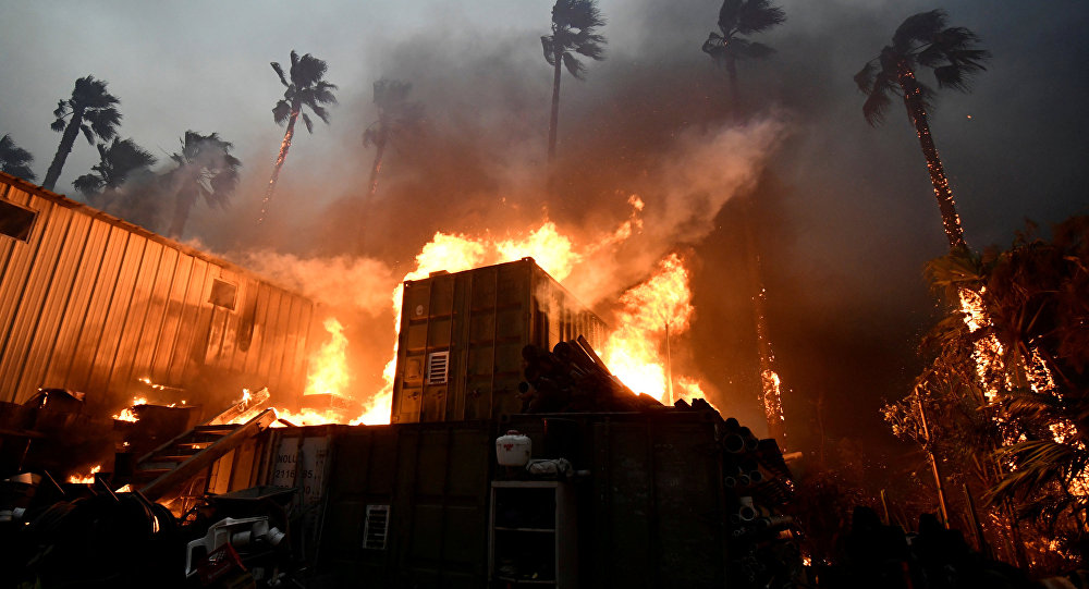 A home is engulfed in flames during the Woolsey Fire in Malibu, California