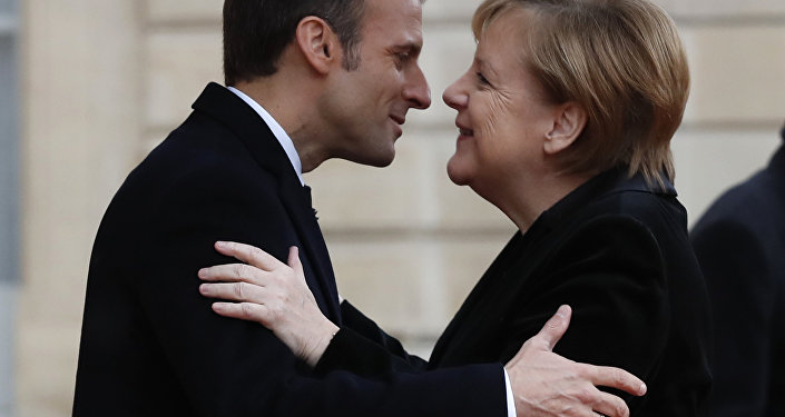 Merkel, Macron sign friendship treaty building on 1963 Elysee accord