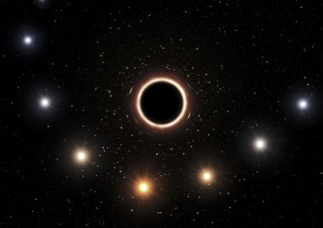 Artist impression shows the path of the star S2 as it passes close to the supermassive black hole at the center of the Milky Way galaxy