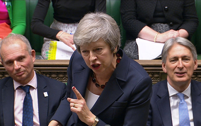 A still image from a video footage shows Britain's Prime Minister Theresa May speaking during Prime Minister's Questions in the House of Commons, in central London, Britain November 14, 2018