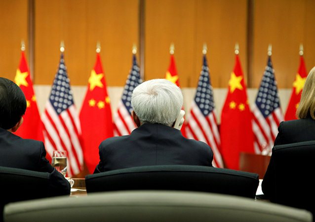 Delegates listen to opening remarks by China's State Councilor Yang and US Deputy Secretary of State Burns at a session of the S&ED in Washington