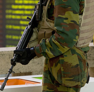 A Belgian Army soldier patrols in the central train station in Brussels on Monday, Nov. 23, 2015.