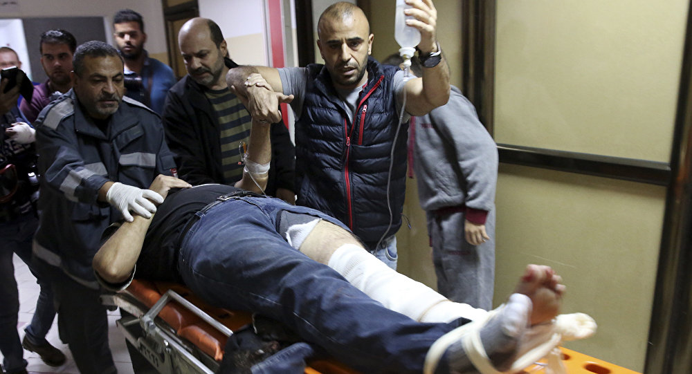 AP photographer Rashed Rashid rushed into the hospital by his colleagues after he was shot in the leg by an Israeli military sniper while filming a protest in Gaza.