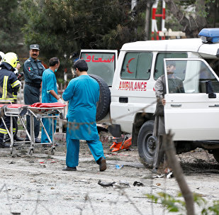 Afghan security forces and medics are seen at the site of a suicide attack in Kabul