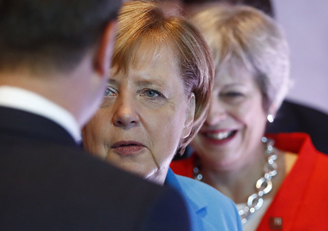 German Chancellor Angela Merkel, left, and British Prime Minister Theresa May wait for the beginning of the plenary session of the informal EU summit in Salzburg, Austria, Thursday, Sept. 20, 2018.