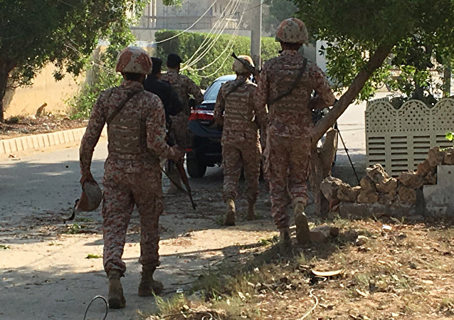 Paramilitary forces and police are seen during an attack on the Chinese embassy, where blasts and shots are heard, in Karachi, Pakistan November 23, 2018.