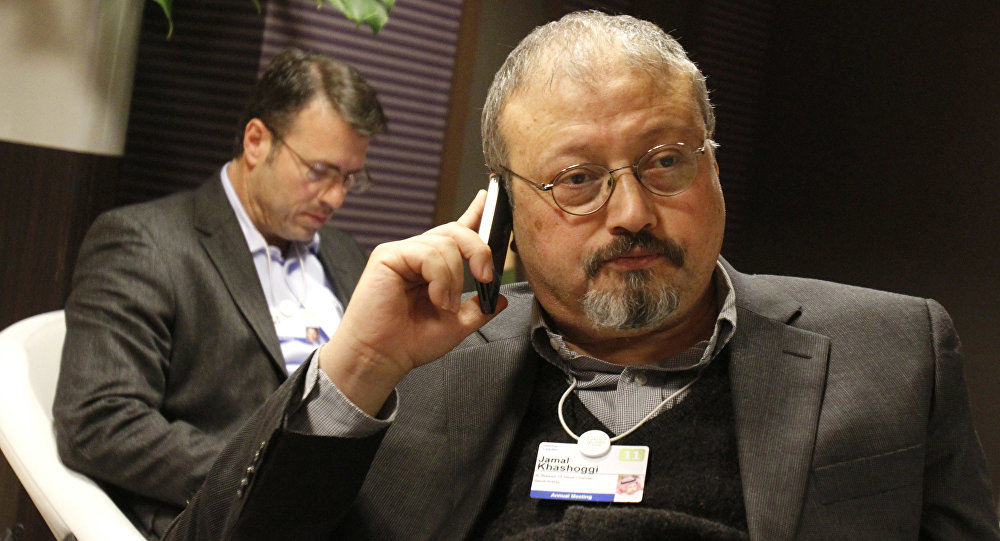 In this Jan. 29, 2011 photo, Saudi journalist Jamal Khashoggi speaks on his cellphone at the World Economic Forum in Davos, Switzerland