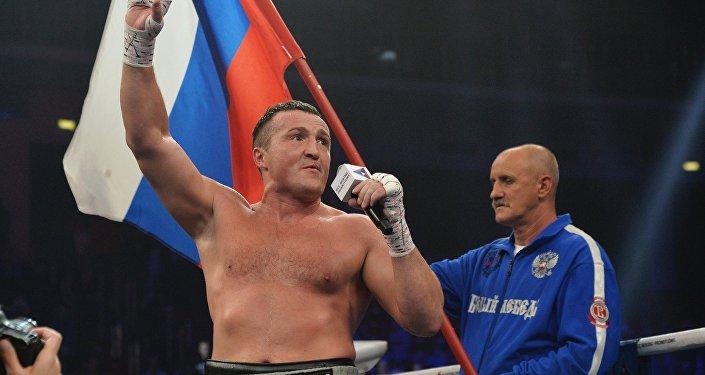 Denis Lebedev (left) is seen after beating Turkish boxer Hizni Altunkaya on September 7, 2018