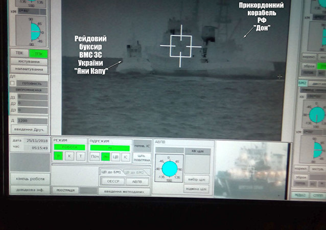 A screen shows a Russian border guard vessel Don stopping a Ukrainian Navy tug boat as three Ukrainian ships attempt to transit from the Black Sea port of Odessa via the Kerch Strait to Mariupol on the Sea of Azov, in the Black Sea in this handout picture taken November 25, 2018 and released by the Ukrainian Navy