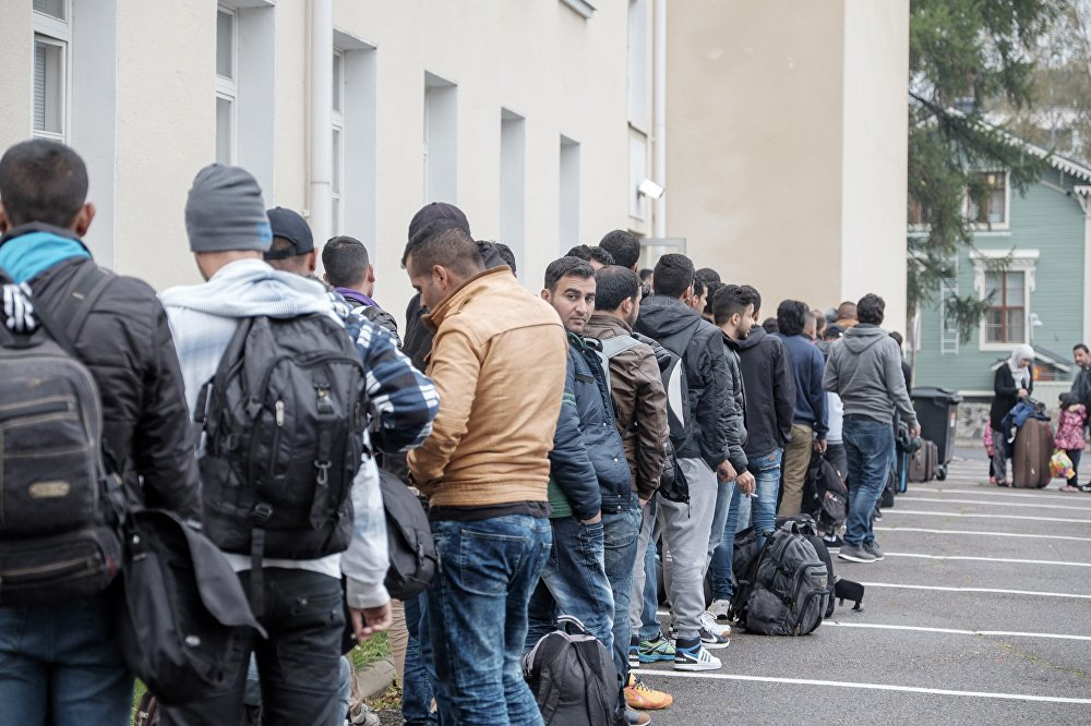 Migrants queue in front of a refugee reception centre in Tornio,Finland (file)
