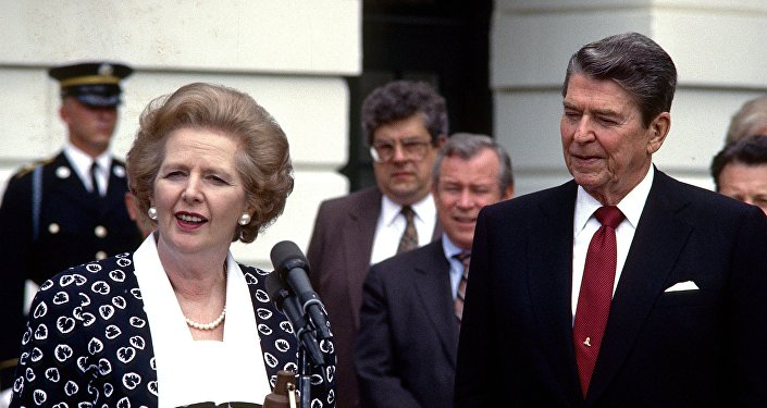 In a Friday, July 17, 1987 file photo, Prime Minister Margaret Thatcher of the United Kingdom, left, makes remarks after visiting United States President Ronald Reagan, right, at the White House in Washington, D.C.