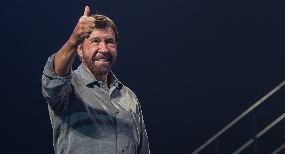 US actor and martial artist Chuck Norris, this year's special guest signals to the audience onstage during the opening gala of the 15th Shoe Box fundraising event in Papp Laszlo Sports Arena in Budapest, Hungary, Saturday, Nov. 24, 2018