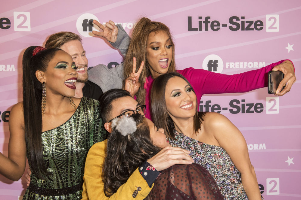 The cast of Life-Size 2 including model and actres Tyra Banks (C) takes a selfie