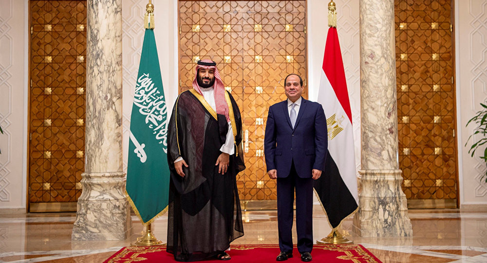 Saudi Arabia's Crown Prince Mohammed bin Salman stands next to Egyptian President Abdel Fattah al-Sisi at the Presidential Palace in Cairo, Egypt November 27, 2018