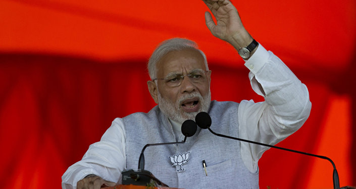 Indian Prime Minister Narendra Modi speaks during an election campaign rally at Mahabubnagar district of Telangana state, India, Tuesday, Nov. 27, 2018. Elections in Telangana state will be held in December