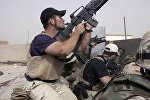 plainclothes contractors working for Blackwater USA take part in a firefight as Iraqi demonstrators loyal to Muqtada al-Sadr attempt to advance on a facility being defended by U.S. and Spanish soldiers in the Iraqi city of Najaf