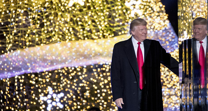 President Donald Trump stands on stage after lighting the 2017 National Christmas Tree on the Ellipse near the White House, Thursday, Nov. 30, 2017, in Washington.