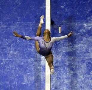 Gabby Douglas competes on the balance beam
