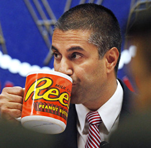 Federal Communications Commission (FCC) Chairman Ajit Pai takes a drink from a mug during an FCC meeting where the FCC voted on net neutrality, in Washington.