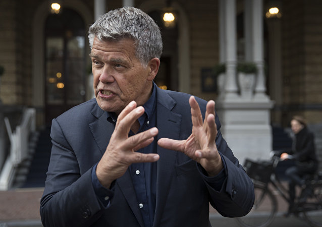 Self-styled Dutch positivity guru Emile Ratelband answers questions during an interview in Amsterdam, Netherlands, Monday, Dec. 3, 2018