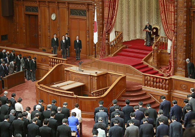 Japan's Emperor Akihito, top, reads a statement to formally open a Diet session at the upper house of parliament in Tokyo, 2016