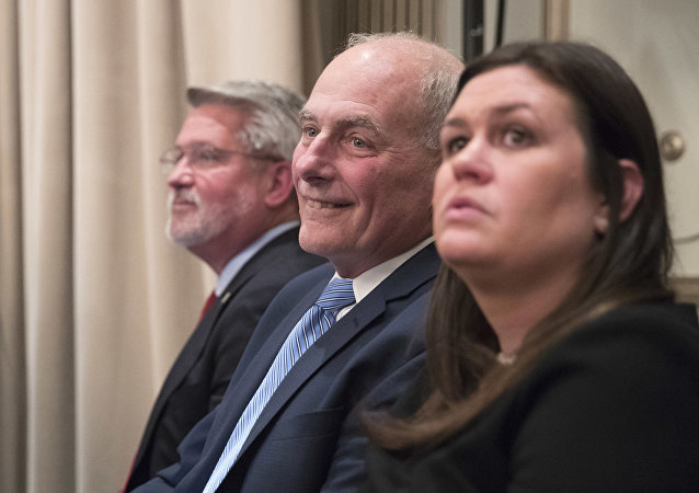 Communications Chief Bill Shine, left, Chief of Staff John Kelly, center, White House Press Secretary Sarah Huckabee Sanders listen as President Donald Trump speaks during a news conference, Wednesday, Sept. 26, 2018, in New York