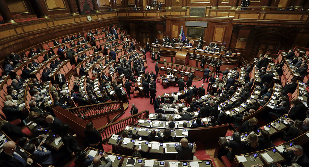 Lawmakers sit during the vote to elect Senate's president, in Rome, Friday, March 23, 2018. Italian lawmakers have formally reconvened parliament following inconclusive March 4 elections without any accord in sight as to the formation of a new government