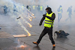 Protestors clash with riot police on December 8, 2018 in Bordeaux, southwestern France, during a demonstration against rising costs of living. The yellow vest movement in France originally started as a protest about planned fuel hikes but has morphed into a mass protest against President's policies and top-down style of governing.