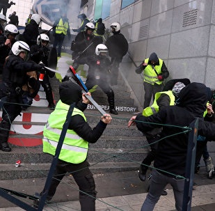 Demonstrators clash with police during the yellow vests protest against higher fuel prices, in Brussels, Belgium, December 8, 2018