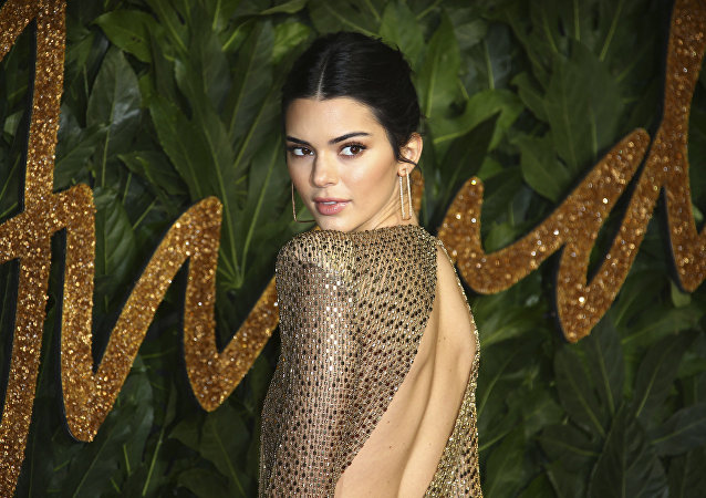 Model Kendall Jenner poses for photographers upon arrival at the The Fashion Awards 2018 in central London, Monday, Dec. 10, 2018