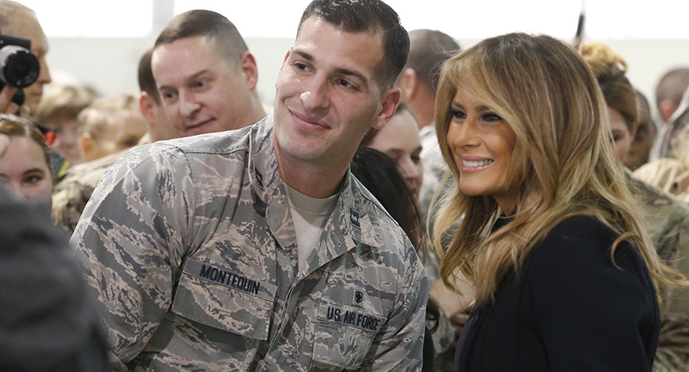First lady Melania Trump , right, poses with an airman during a tour of Joint Base Langley in Hampton, Va., Wednesday, Dec. 12, 2018