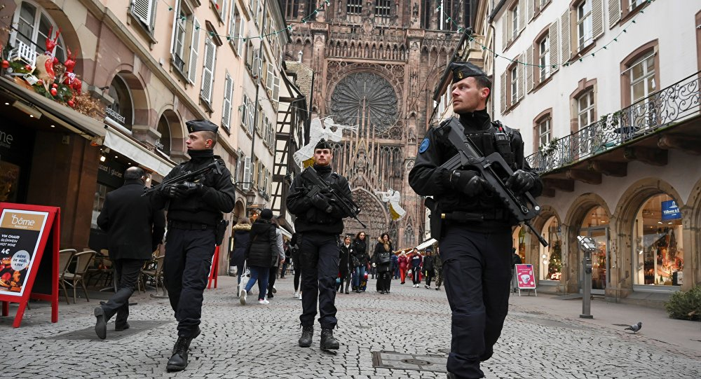 French policemen patrol during the reopening of the christmas market of Strasbourg, eastern France, on December 14, 2018 as the author of the attack was killed on December 13, 2018.