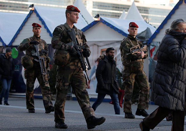 French soldiers patrol at the Christmas market at La Defense financial and business district in Puteaux, near Paris, France, December 13, 2018
