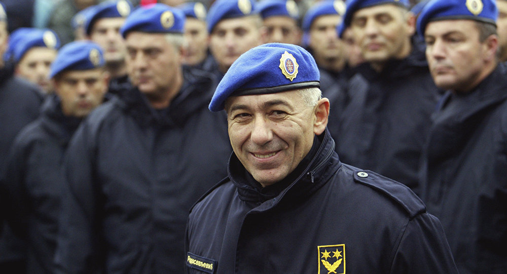 In this photo taken Oct. 24, 2003, former Police Gen. Goran Radosavljevic Guri stands in front of Serbia's elite police troops during a protest in downtown Belgrade, Serbia.