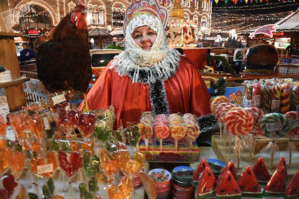 A lollipop vendor at the traditional GUM Fair near the GUM skating rink on Moscow's Red Square.