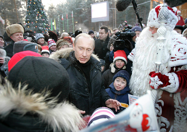 President Vladimir Putin meeting with children outside Grandfather Frost's residence in Veliky Ustyug