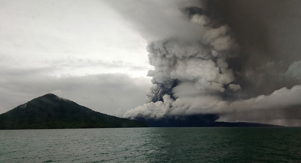 This picture taken on December 26, 2018 shows the Anak (Child) Krakatoa volcano erupting, as seen from a ship on the Sunda Straits. Indonesia on December 27 raised the danger alert level for a volcano that sparked a killer tsunami, after previously warning that fresh activity at the crater threatened to launch another deadly wave