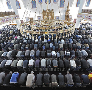 Muslims pray at a mosque for the Eid al-Fitr holiday