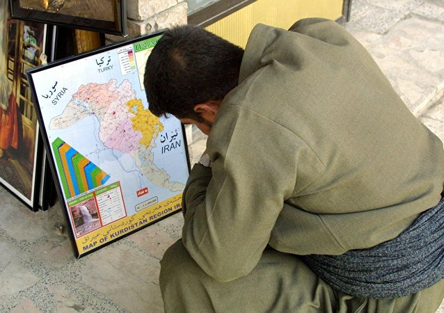 An Iraqi Kurd observes the kurdish enclave on an Iraqi map (File)