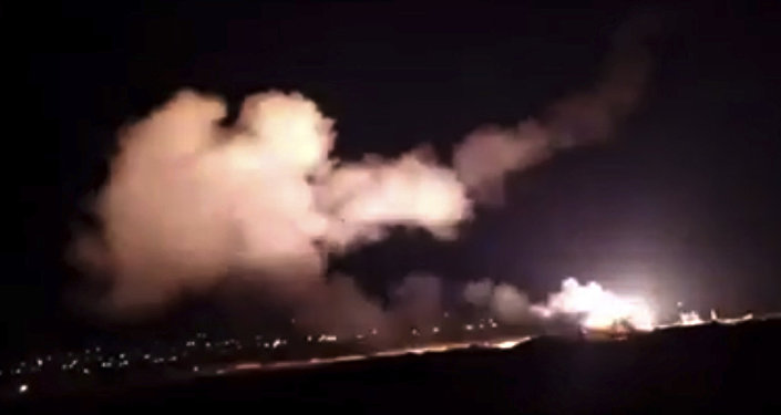 This frame grab from a video provided by the Syrian official news agency SANA shows missiles flying into the sky near Damascus, Syria, 25 December