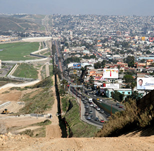 on the US-Mexico border. To the left San Diego, California, US. To the right Tijuana, Baja California, Mexico.