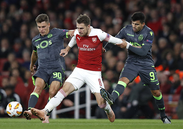Arsenal's Aaron Ramsey, pictured taking on two Sporting Lisbon defenders, may be leaving in January