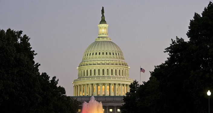 The US Congress building is seen at dusk on the eve of a possible government shutdown as Congress battles out the budget in Washington, DC, September 30, 2013.