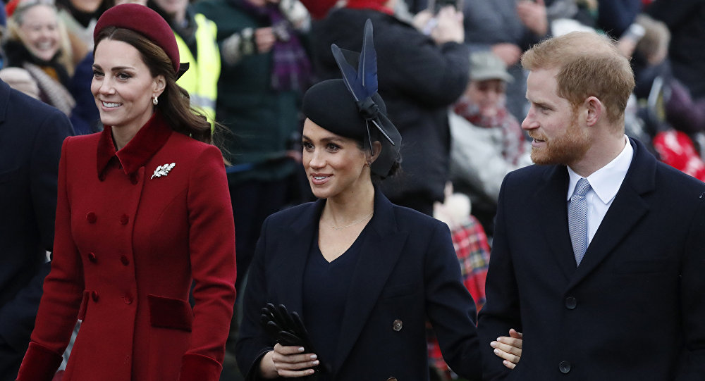 Britain's Kate, Duchess of Cambridge, left, Meghan Duchess of Sussex and Prince Harry, right, arrive to attend the Christmas day service at St Mary Magdalene Church in Sandringham in Norfolk, England, Tuesday, Dec. 25, 2018.