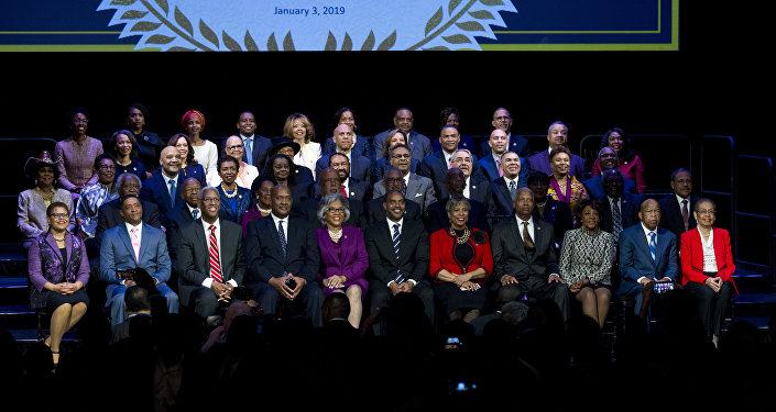 Members of the Congressional Black Caucus participate in a swearing-in ceremony at The Warner Theatre in Washington, Thursday, Jan. 3, 2019.