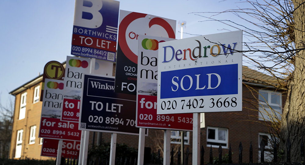 Estate Agent boards stand outside properties in London, Friday, Jan. 4, 2019.